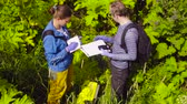 gps : The ecologist checking with the GPS navigator Stock Footage
