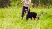 лохматый : Woman playing with bernese shepherd dog