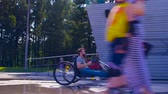 inválido : Happy young disable man is riding hand bike