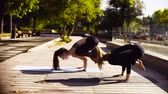 протяжение : Yoga. Two attractive woman doing yoga exersices in the park