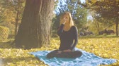 Young attractive woman doing pranayama in the park