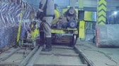 금속 세공 : Unrecognizable workers producing metal net in the factory