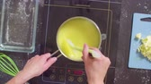 coalhada : Hands of a confectioner cooking lemon curd Stock Footage