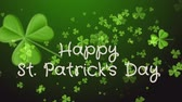 celta : Happy Saint Patricks Day. Falling clover leaves over dark green background