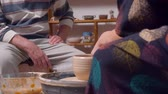 cruche : Two people in a pottery workshop Vidéos Libres De Droits