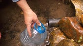 studnia : Equipped well. Clear water pouring from the pipe