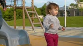 nemluvně : Small cheerful baby girl on the slide