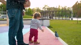 nemluvně : Funny baby walks over a dove in the park