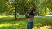 fiel : Beautiful girl with the dog in the park Vídeos