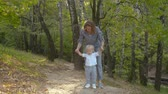 anyaság : Mother walking with baby boy in the park