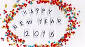 confete : Happy new Year 2015 celebration stop motion confetti. Ideal for animated greeting card.
