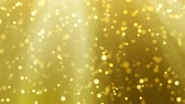 Gold Christmas light loop background, glitter effect template. Elegant golden blur falling falling leaves. Xmas card 4k animation footage.