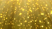 Gold Christmas light background, glitter effect template. Elegant sparkle texture of golden blur particles falling for celebration or holiday season. Xmas card 4k animation footage.