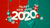 Happy New Year 2020 animation, paper cut with baubles, gift and holiday pine tree. Paper craft video greeting card of calendar number for eve party, xmas footage fade out to black background. 影像素材