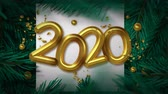 Happy New Year 2020 video card animation of zoom close up gold 3d calendar number sign with green xmas pine tree. Festive background or holiday event intro 4k footage.