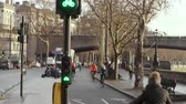 Cyclists ride past cycle traffic lights