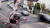 скрестив : A Train passes a Level crossing in London