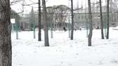 вратарь : Mens team of football players trains on a snowy winter field