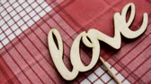shabby : Love the word. Love the wooden letters on the red checkered napkin Stock Footage