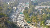автомобиль : a view from above of the freeway with a long lens. Стоковые видеозаписи