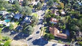 evde : Aerial of a southern California neighborhood with streets and homes, Stok Video
