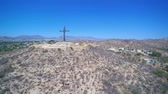 Иисус : Aerial of a cross on hill in Mexico Стоковые видеозаписи