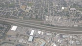 Aerial footage taken from an airliner flying over a city in Canada tracking the highway.
