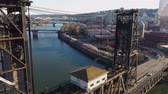 gyalogút : Aerial footage flying over the Steel Bridge towards the Cherry blossom trees at the Waterfront in downtown Portland, Oregon. Stock mozgókép