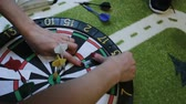 дартс : Girl glues paper on a dart board Стоковые видеозаписи