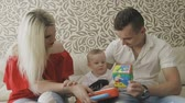 öpme : Father and mother are playing with their little child. Family at home
