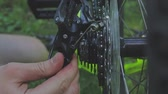 serviceman : bike assembly. Mechanic repairing wheel in bicycles workshop. Mechanic repairing bicycle in workshop. Bicycle shop. Professional mechanic setting up chain on bicycle in workshop. Bike repair. Stock Footage