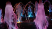 fountain show : Colorful musical fountain at night, shimmering in different colors.