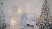 złota rybka : 2019. New year 2019. New Years decor, colorful garlands, Christmas socks. Christmas tree on the Christmas tree. Interior decor. A party. Waiting for the holiday. Bokeh, the blue light. New Year