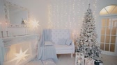 золотая рыбка : 2019. New year 2019. New Years decor, colorful garlands, Christmas socks. Christmas tree on the Christmas tree. Interior decor. A party. Waiting for the holiday. Bokeh, the blue light. New Year