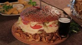 cheese sauce : Huge delicious burger with potatoes and fizzy drink. Stock Footage