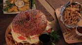 barbequed : Huge delicious burger with potatoes and fizzy drink. Stock Footage