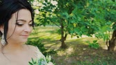 wedding bouquet : Beautiful bride with wedding bouquet in the park.