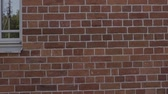 bricklayer : Slow motion handheld closeup pan of filled seams on brick wall.