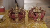 nupcial : Church attributes for wedding ceremony. Gold crowns are on the altar.