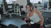 sportovní výstroj : Young active girl lifts dumbbell for sitting biceps.