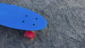граница : Skateboard standing on the sand in bright weather.