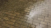 bloc de pierre : Wet after the rain paving slabs on the street