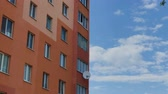 gerçek : Large residential building against the sky and beautiful clouds. Stok Video