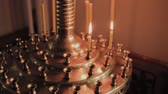 聖なる : Burning church candles on a candlestick during church services.
