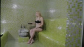 steam room : A beautiful girl pours water in a hammam. Spa treatments.