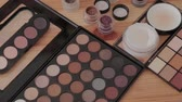art product : Professional makeup kit in a makeup studio on a wooden table. Stock Footage