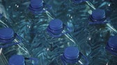 재 : Blue plastic drinking water bottles in large quantities. 무비클립