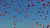 sky : A sky full of red balloons floating upwards.