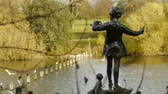 Питер : The bronze of Peter Pan in Kensington Gardens is one of the most popular statues in London. He stands in a leafy glade about half way along the west bank of the Long Water. This site has a special importance for Peter Pan and was chosen for the statue by