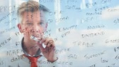 anahtar kelimeler : Reflection of a creative businessman brainstorming writing business keywords onto glass